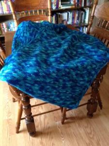 Blue crocheted prayer shawl